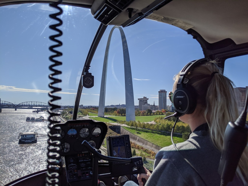 View of inside of helicopter with Gateway Arch beyond