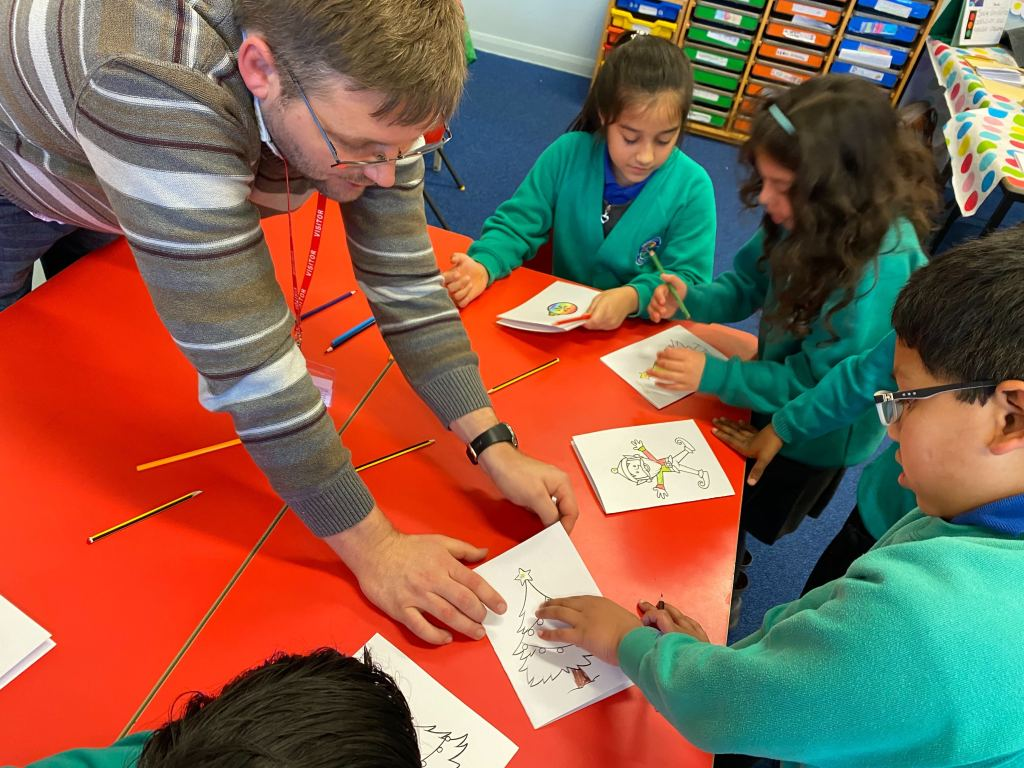 Box UK team member showing school children how to create light-up cards