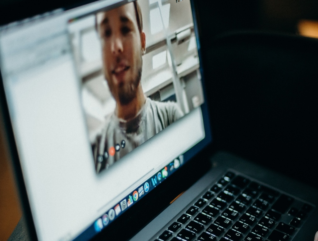 Laptop showing man on video call