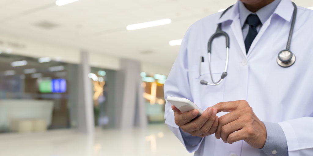 Medical professional using smartphone