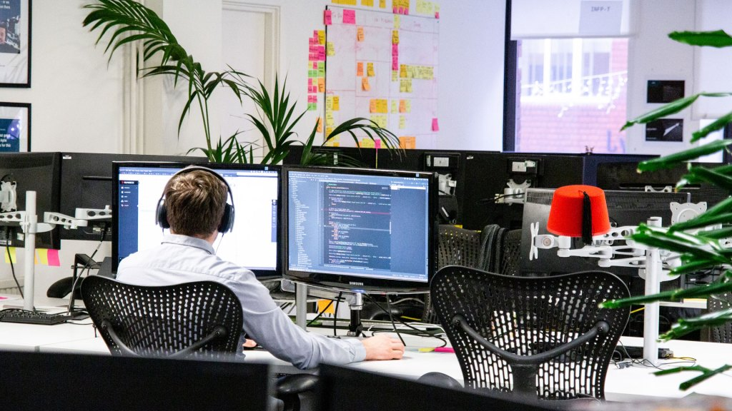 Developer working at two screens