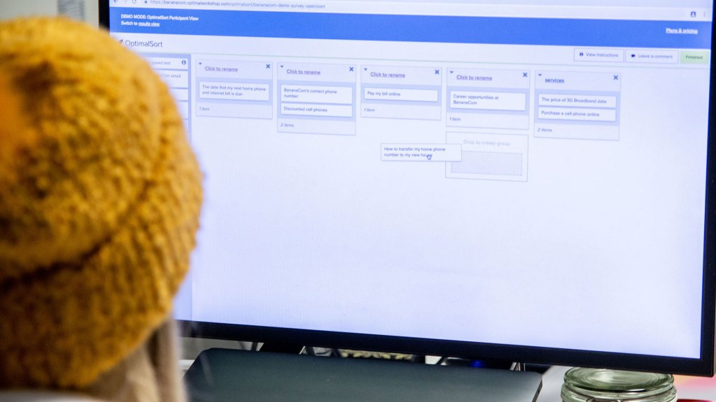 Person completing card sorting usability test online