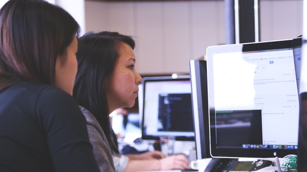 Two people looking at a computer screen