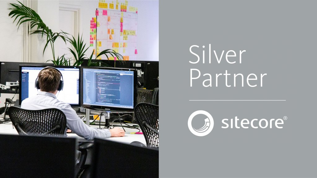 Sitecore Silver Partner logo and photo of developer at work
