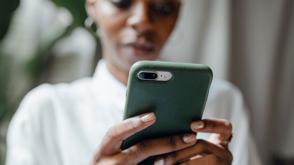 Close up of a smartphone being held by a woman