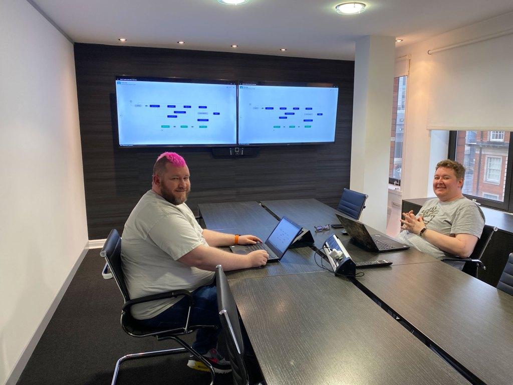 People hosting a meetup using a Zoom Room setup