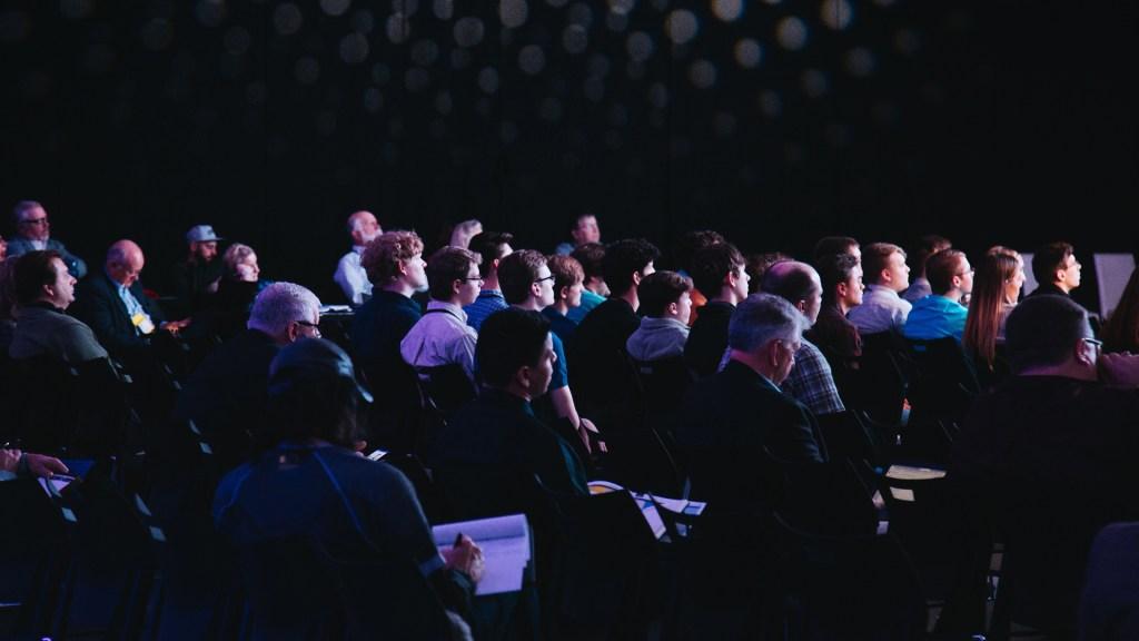 Audience sat in an auditorium
