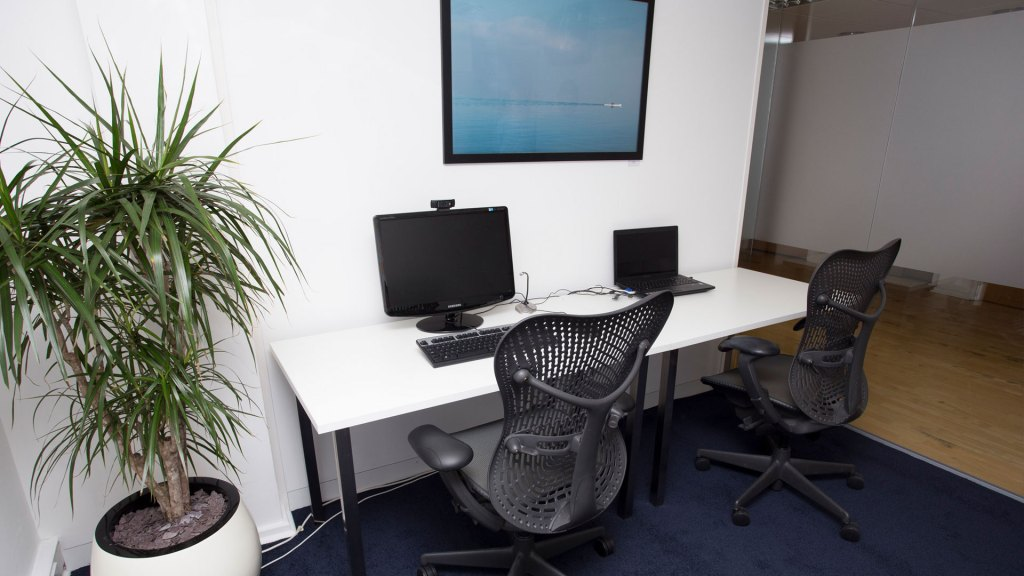 Usability testing lab with desktop and laptop devices set up